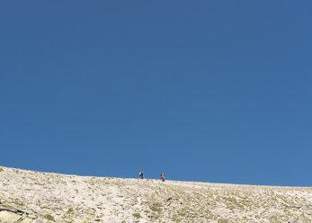 Mountaineers walking over empty plane - ALRF01319