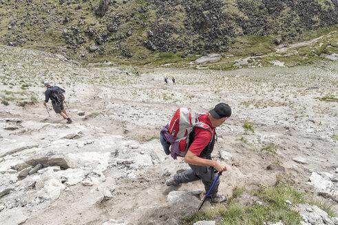 Russia, Caucasus, Mountaineers hiking in Upper Baksan Valley - ALRF01349