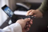 Handing over credit card - DIGF05118