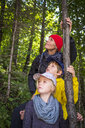 Germany, Upper Bavaria, Mother and children in a forest - HAMF00405