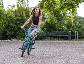 Young woman riding her BMX bike - STSF01760