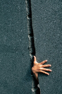 A human hand appearing out of a crack - INGF00615