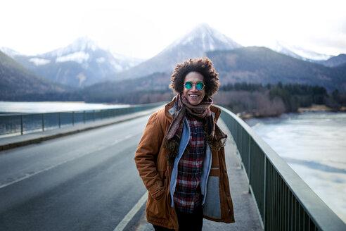 Young man enjoying the mountain views in winter - INGF01176