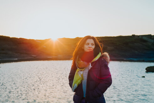 Woman by sea at sunset, Liscannor, Clare, Ireland - CUF46219