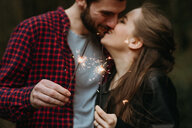 Couple holding sparklers - CUF46243