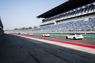 Cars in a row on racetrack - HAMF00434