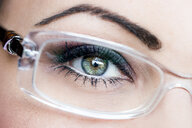Woman's eye, glasses, close-up - PUF01325