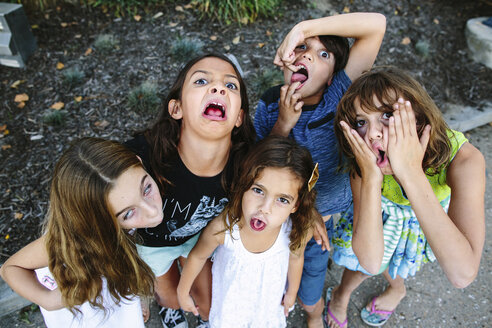 High angle portrait of siblings making faces while standing at park - CAVF49115