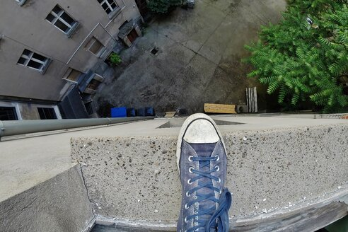 Standing on high building ledge - INGF01360