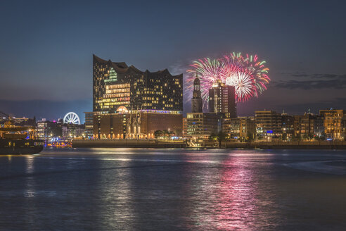 Germany, Hamburg, Elbe Philharmonic Hall, St. Michaelis Church, fireworks at night - KEBF00956