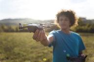 Boy flying a drone outdoors - DIGF05134