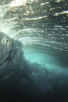 Waves breaking underwater in sea at Maldives - CAVF49580