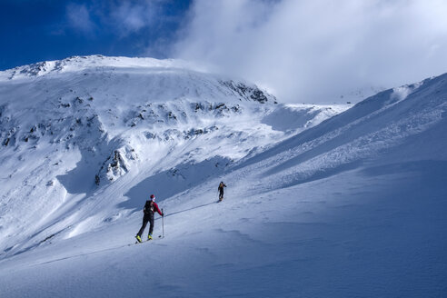 Two men doing a ski tour in Faragas mountains, Southern Carpathians, Romania - HAMF00498