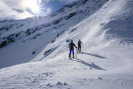 Two men doing a ski tour in Faragas mountains, Southern Carpathians, Romania - HAMF00504