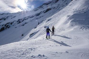Two men doing a ski tour in Faragas mountains, Southern Carpathians, Romania - HAMF00504