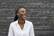 Portrait of laughing businesswoman  wearing white shirt - IGGF00664