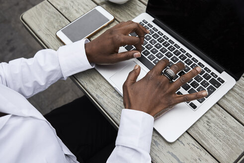 Hands of businesswoman typing on laptop - IGGF00685