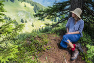Female hiker sitting on viewpoint - HAMF00521