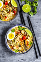 Ramen soup with egg, noodles, chicken meat, paprika, mushroom, spring onion, lime and coriander - SARF03949