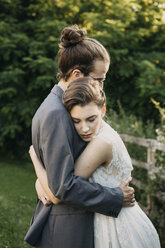 Bride and groom embracing outdoors - ALBF00673