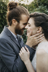 Happy affectionate bride and groom outdoors - ALBF00679