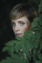 Portrait of a woman behind leaves - ALBF00682