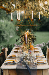 Festive laid table with candles outdoors - ALBF00700