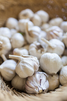High angle view of garlic in basket for sale at market - CAVF49964
