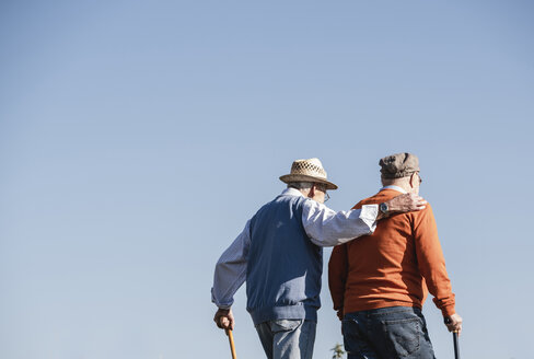 Two old friends taking a stroll through the fields, talking about old times - UUF15467