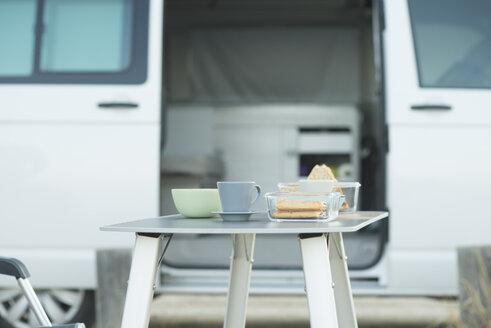 Van and laid breakfast table - SKCF00542