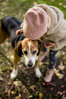 Little girl kissing dog in autumnal garden - PSIF00125