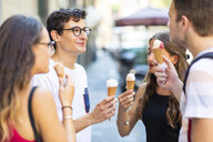 Group of friends meeting in the city and eating ice cream - WPEF00933