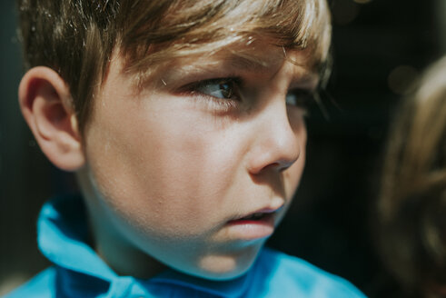 Close-up of thoughtful boy looking away - CAVF50264