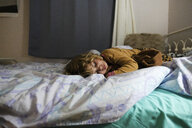 Cute girl sleeping on bed at home - CAVF50446