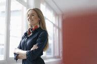 Portrait of smiling young stewardess - KNSF05011
