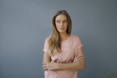 Portrait of young woman wearing pink t-shirt - KNSF05014