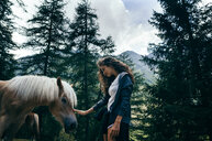 Woman with horse in forest - INGF03076