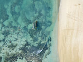 Indonesia, Lombok, Aerial view of beach, banca boat - KNTF02199