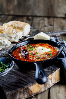 Eggs in Purgatory, eggs, baked in very spicy tomato sauce, sprinkled with parsley and parmegiano - SBDF03786