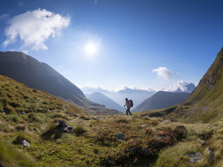 Italy, Lombardy, Bergamasque Alps, hiker on the way to Passo del Gatto, Cima Bagozza and Mount Camino - LAF02117