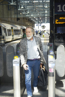 Senior man in train station - LUXF01704