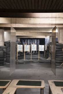 Boards with male likeness as targets in an indoor shooting range - KKAF02578