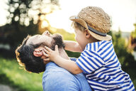Little boy having fun with his father outdoors - HAPF02794