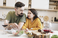 Couple in love having lunch together at home - KMKF00600
