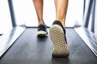 Person running on a treadmill - JSMF00480