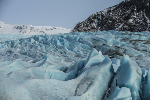 Close-up of Mendenhall Glacier by mountains - CAVF50706