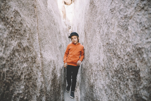 Portrait of boy standing by rock formations at Joshua Tree National Park - CAVF50778