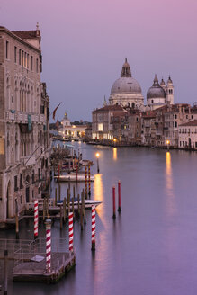 Grand Canal amidst buildings in city against sky during sunset - CAVF50784