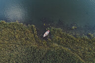 High angle view of boat moored at lakeshore in forest - CAVF50880