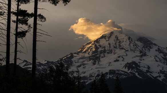 Scenic view of snowcapped mountain against cloudy sky during sunset - CAVF50940